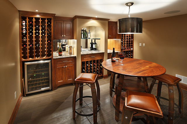 basement bar setting with cherry wood table and stools