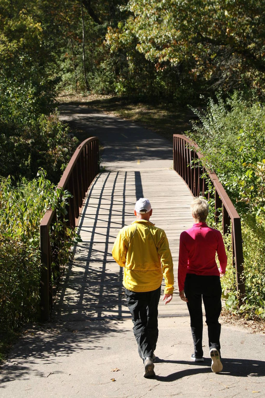 Couple walking a trail