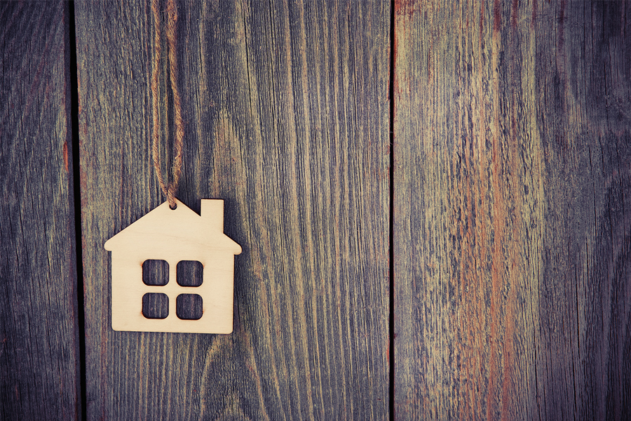 Small home charm on wood background