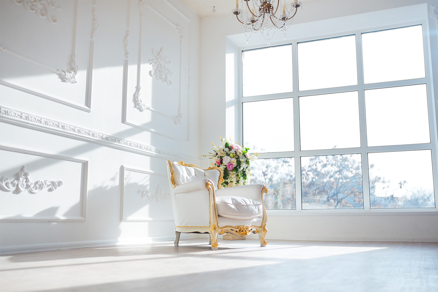 large white spring room with white chair and big windown
