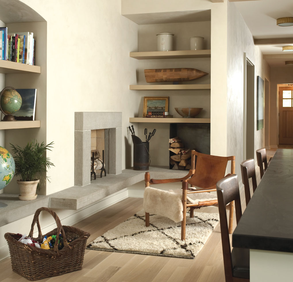 Corridor with decorative accents like a fireplace and shelving displays