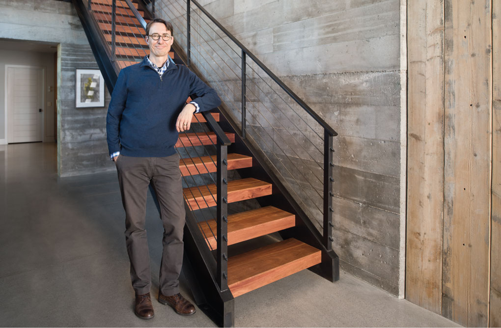 Mark Larson Stands by the Staircase of the Buckeye Point Project