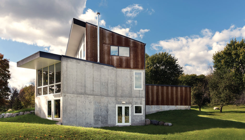 Exterior of Modern Farmhouse is heavy in concrete