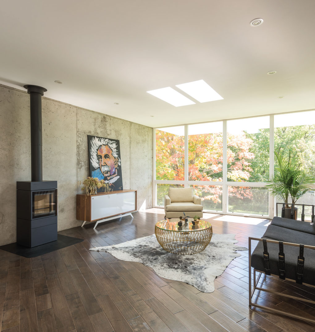 Central family space features old-fashioned fireplace, animal skin rug, and round coffee table