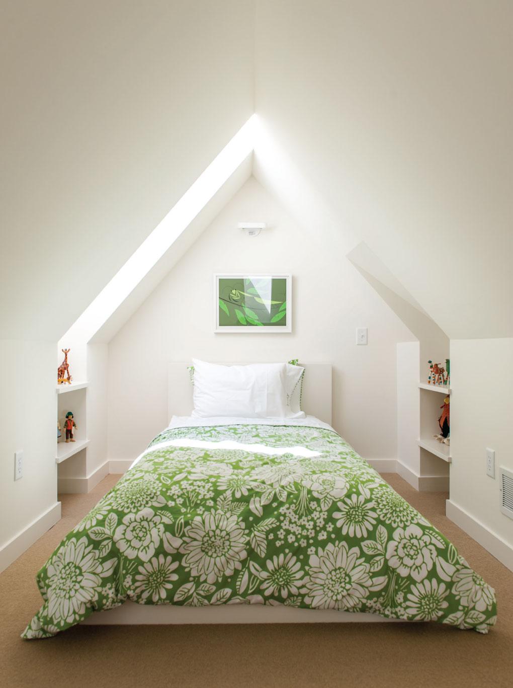 Second-floor bedroom features natural light and green motif