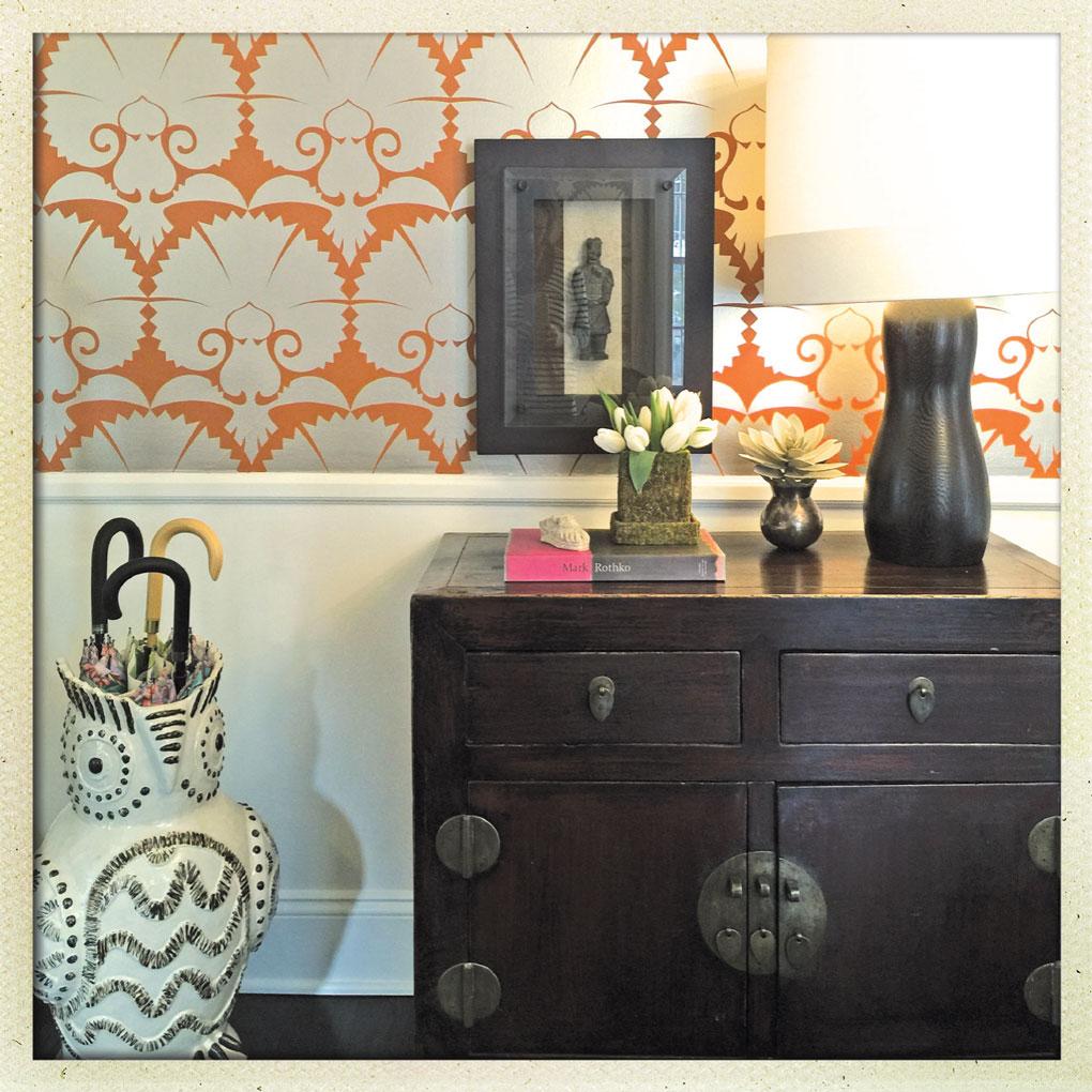 Black Dresser with a Patterned Wallpaper