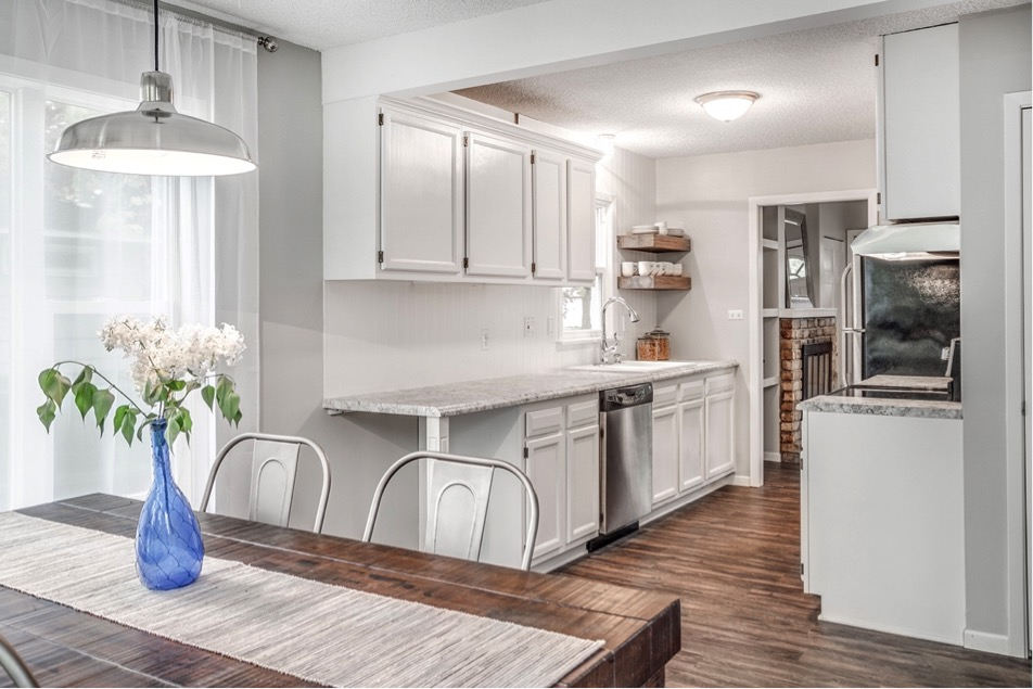 remodeled white kitchen and wood table