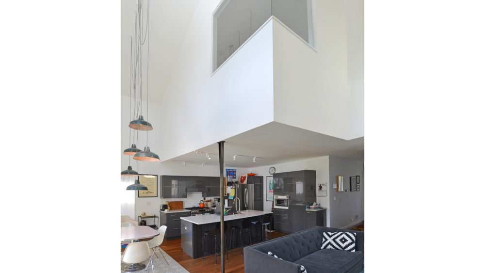 The kitchen height is an intimate 8 feet; the loft nearly 20-feet high.