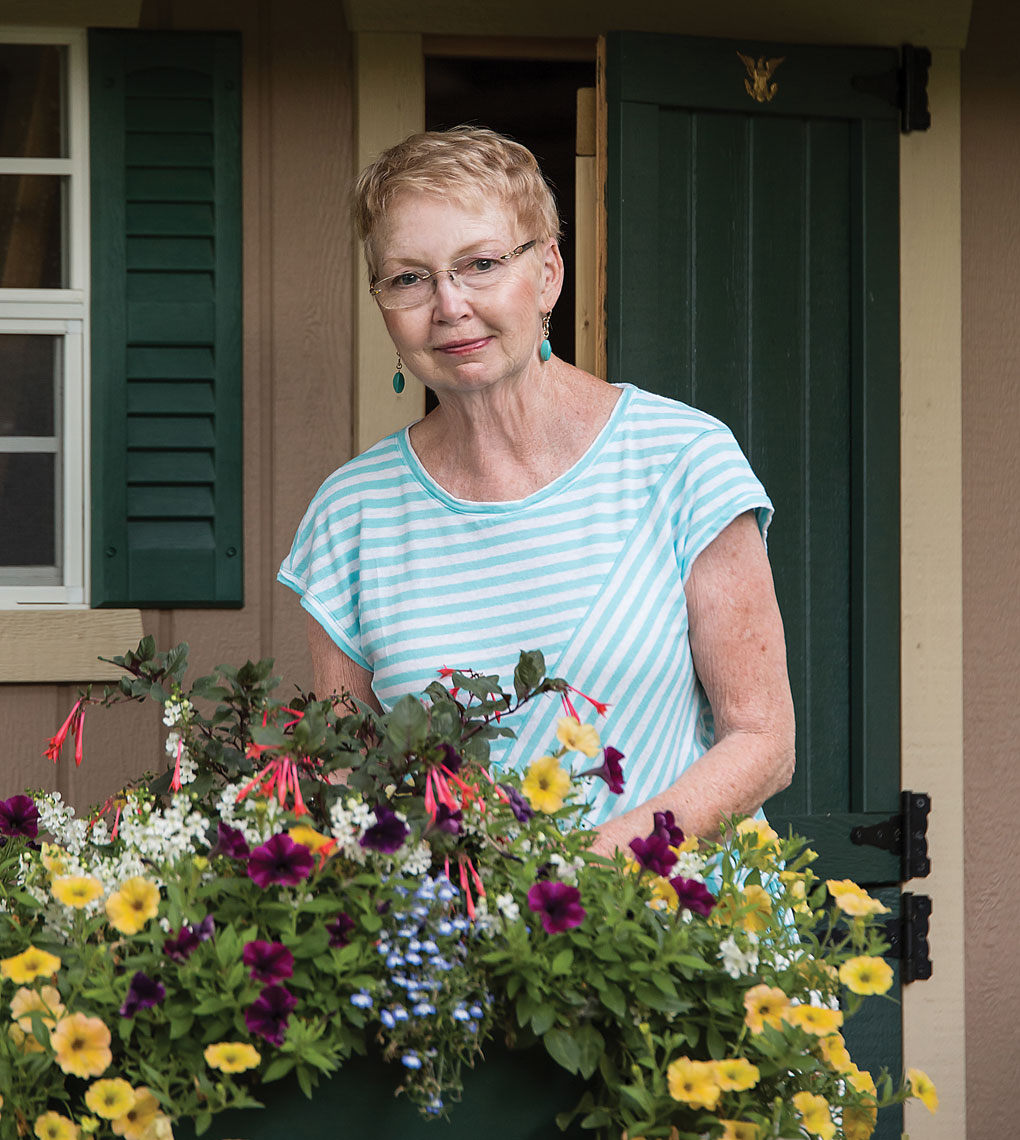 A picture of Sandy Lester working with some flowers.