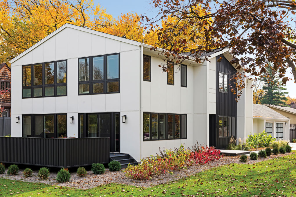 A new remodel of a rambler shows a more modern look with large windows.