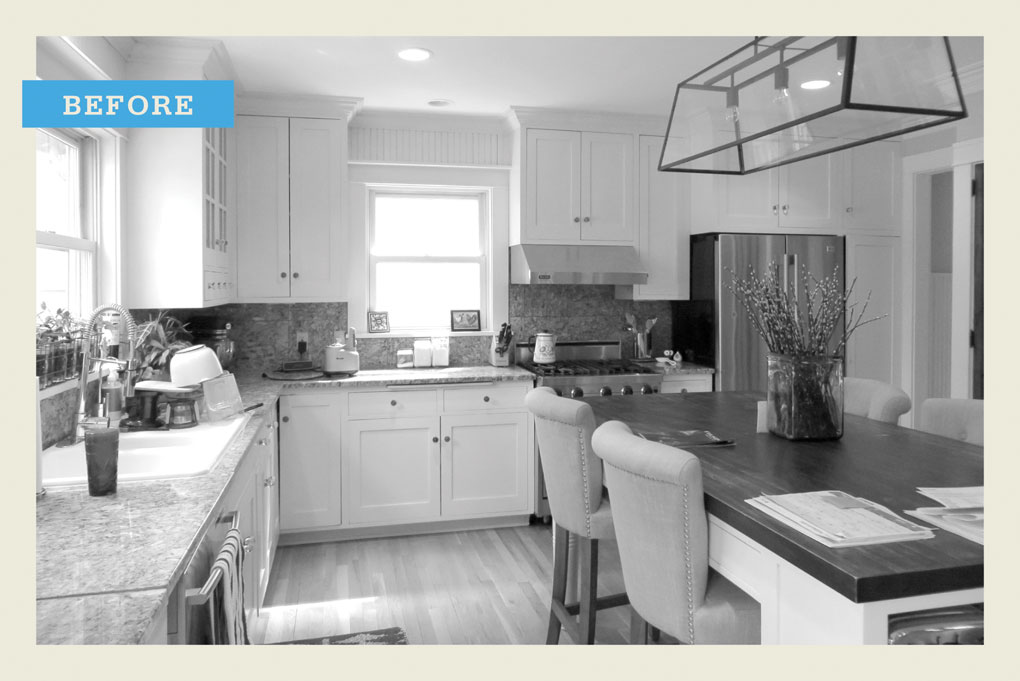 """A black and white """"before"""" photo of a kitchen before being remodeled."""