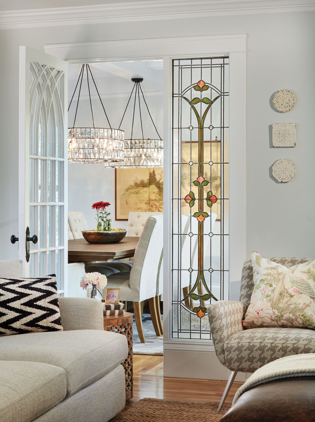 A stained glass window separates the family and dining rooms.