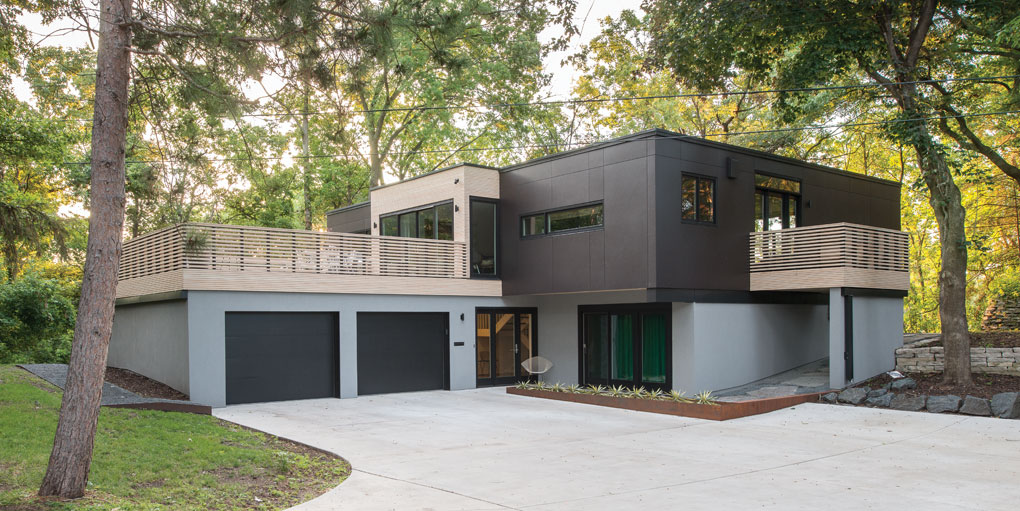 A picture of a modern, two-story home with a renovated exterior.