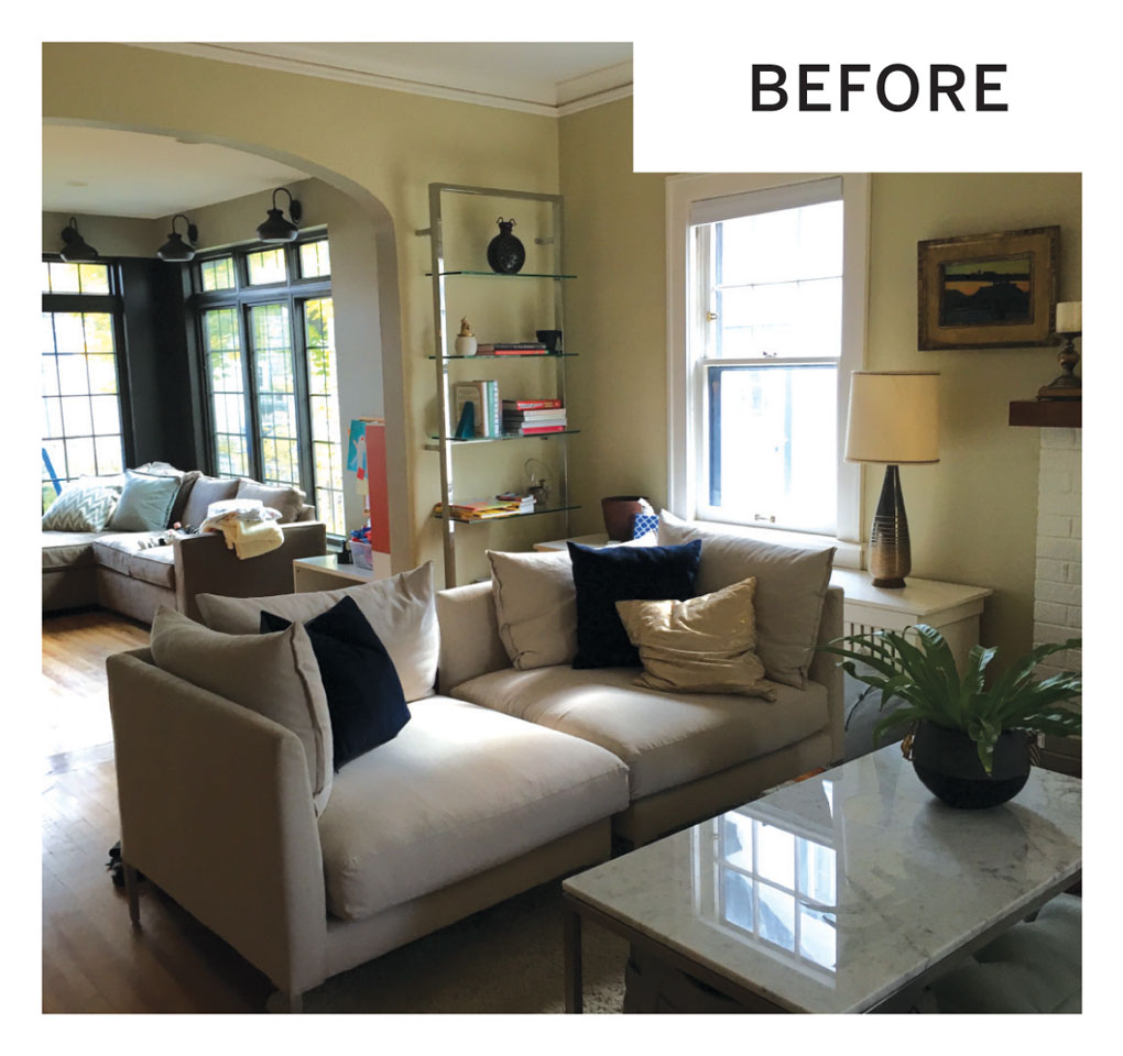 """The """"before"""" photo of a living room shows a sofa next to a coffee table. Behind it sits display shelves with books and other decor."""