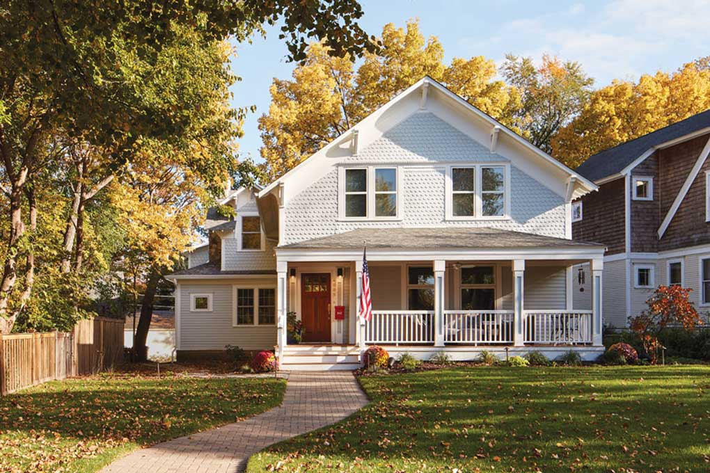 The facade of a Linden Hills home shows an old-fashioned porch and fish-scale cedar shakes.
