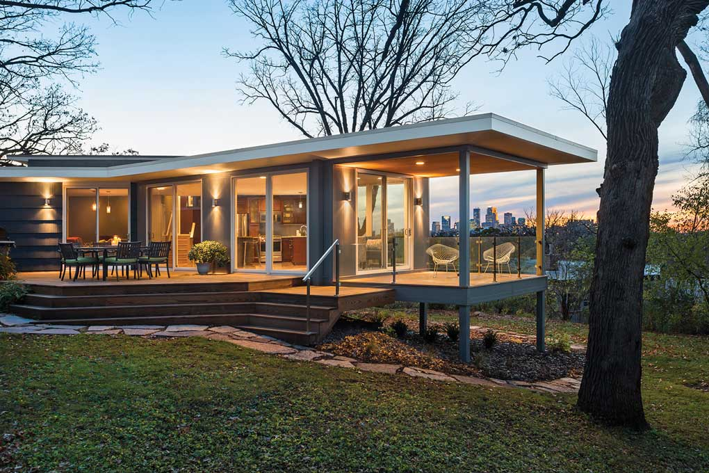 An exterior of a home designed by Design Filter with the Minneapolis skyline in the background.
