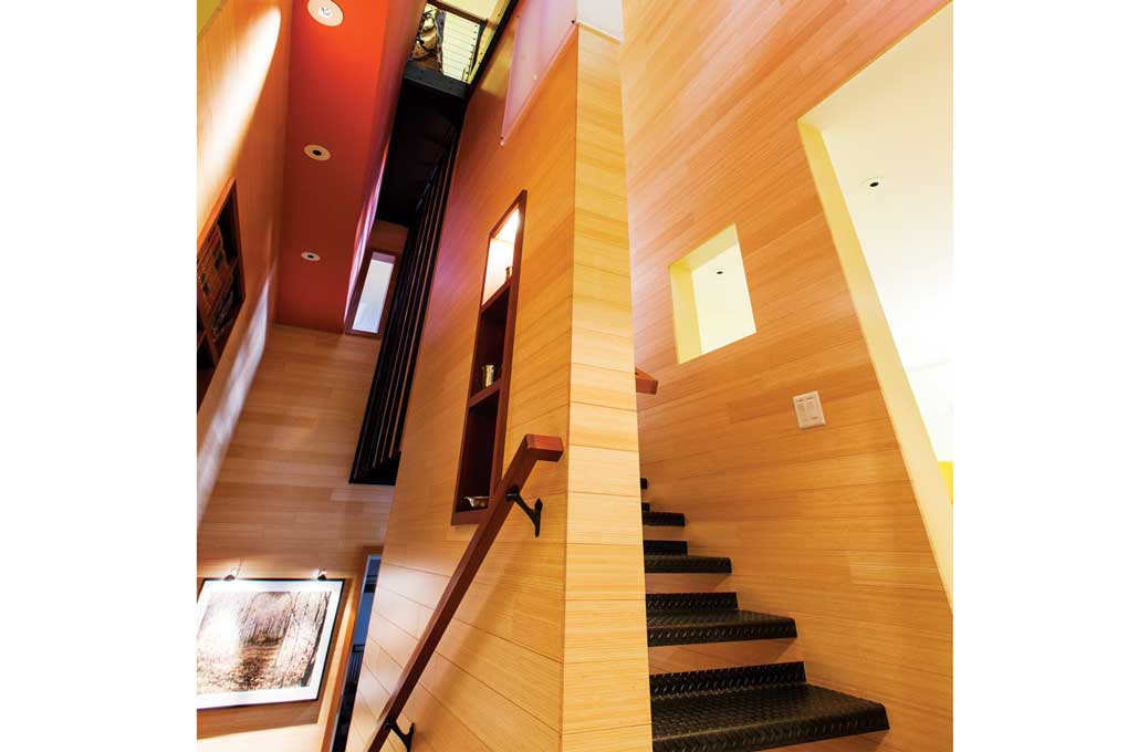 A stairway made of light-colored wood built by Locus Architecture.