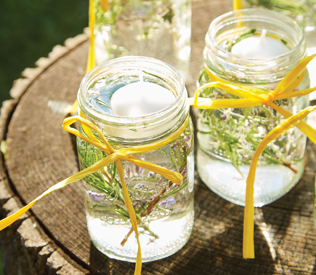 A DIY luminary made out lemon, lime, rosemary and essential oils that doubles as non-toxic insect repellent.