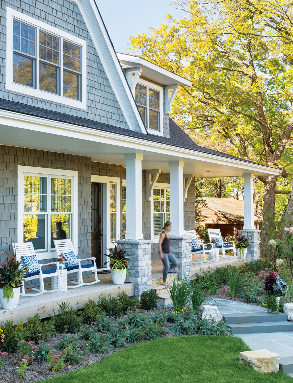 The exterior of a Lake Minnetonka home features an old-fashioned sitting porch and an East Coast-inspired look.