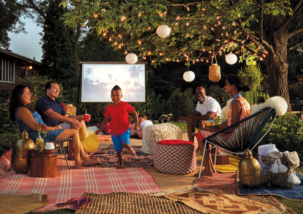 Friends and family gather for an outdoor movie night.