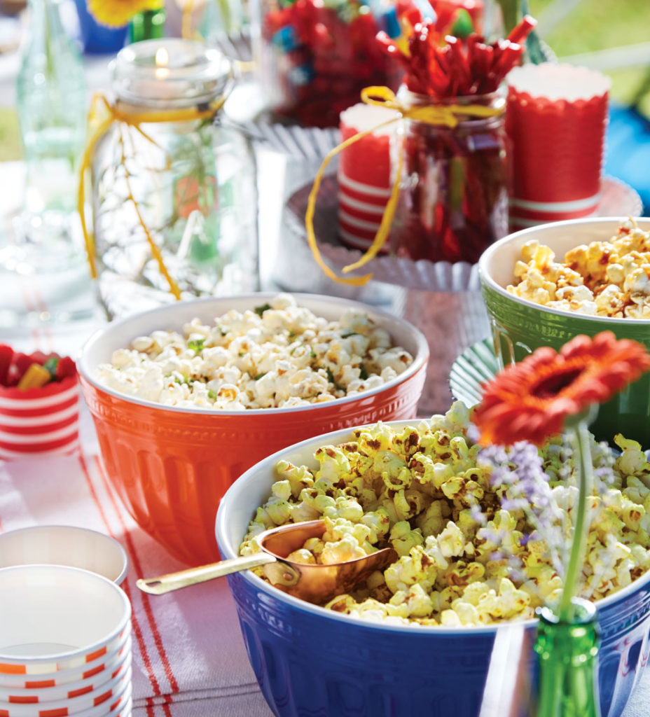 A variety of popcorn choices at an outdoor movie night.