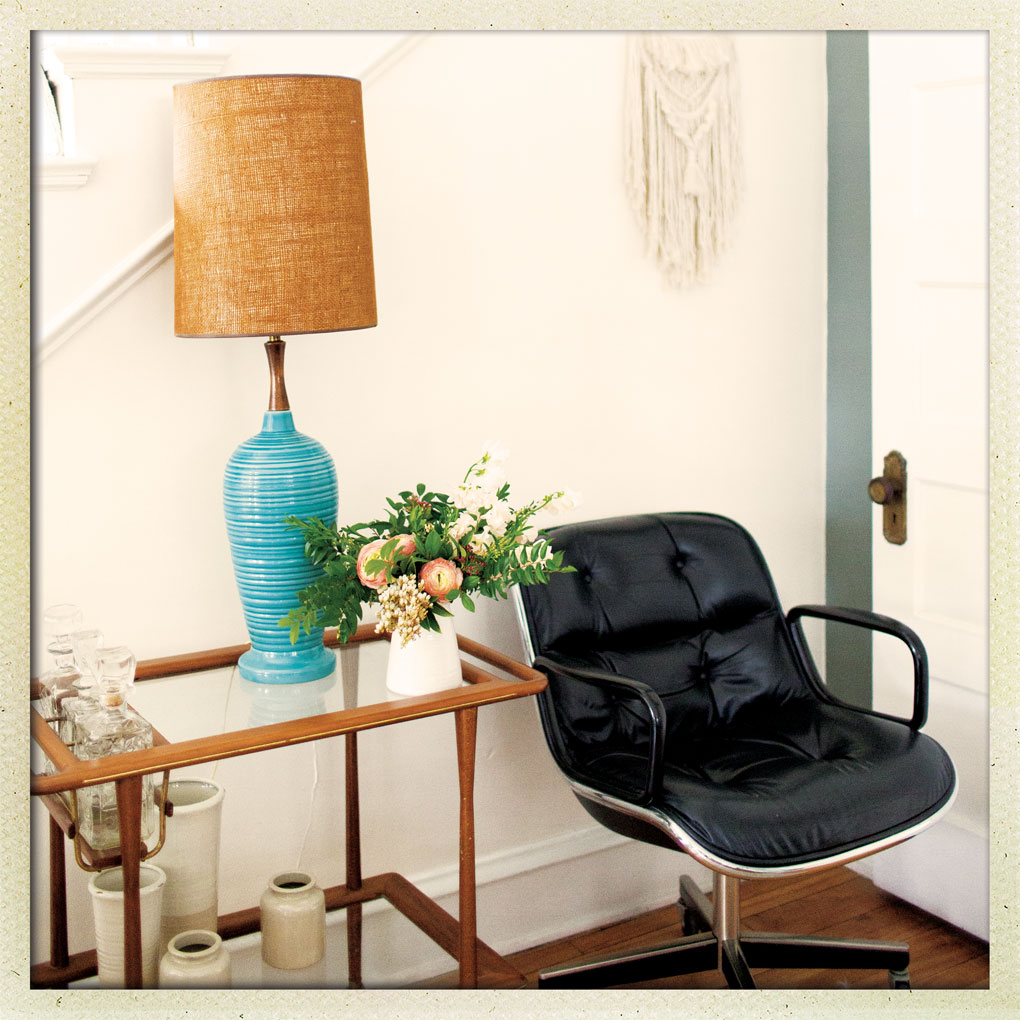 A midcentury lamp is right at home next to one of Jackie Reisenauer's treasure knoll chairs.