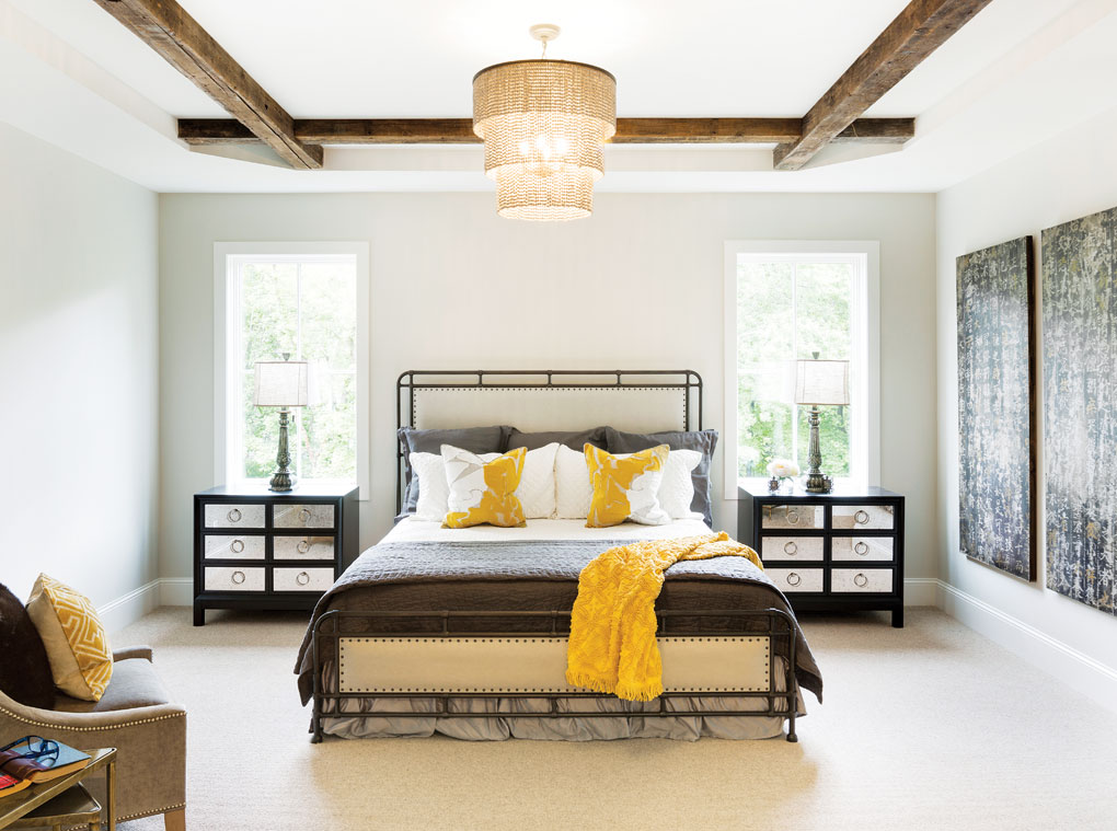 The master bedroom features tray ceilings outlined with reclaimed timbers.
