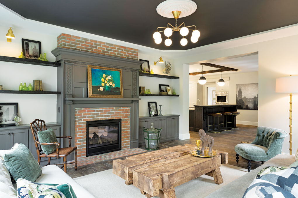 The living room features a two-sided fireplace, reclaimed and painted mantel, and ceiling medallion.