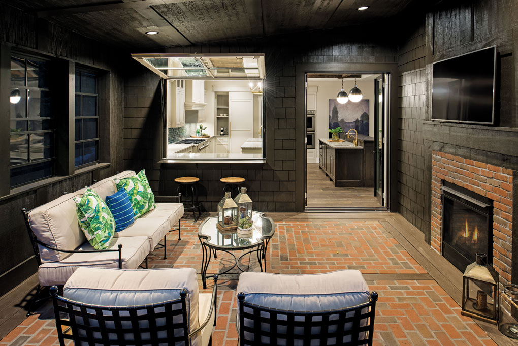 The cafe window between the screen porch and kitchen eases serving and entertaining.