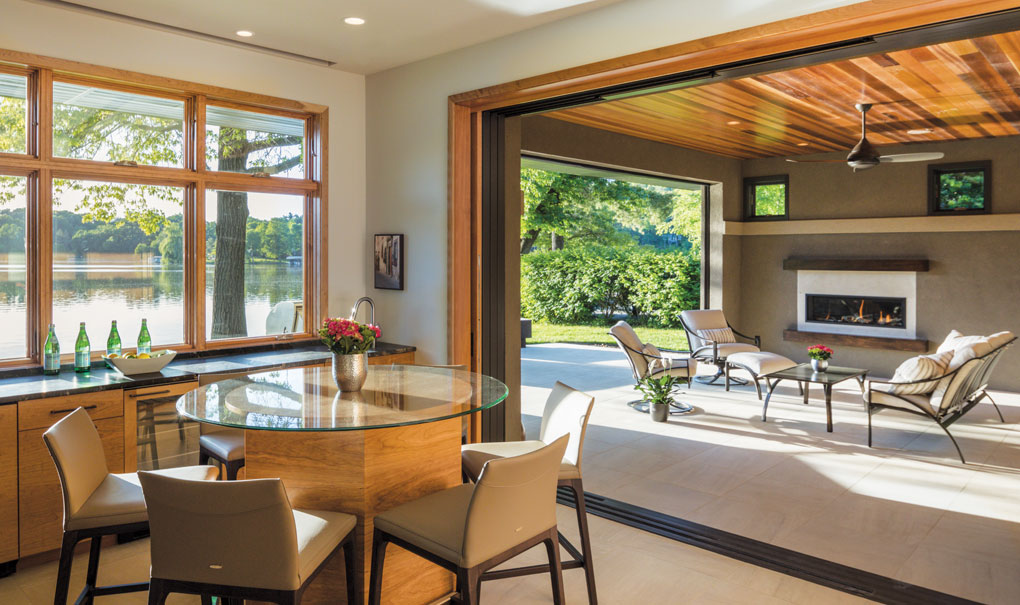The perfect setting for open-air parties (a screen door bars unwanted pests), the bar area features a built-in table (the top will be hammered copper) and cabinetry along two sides.