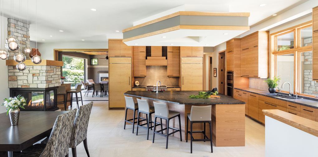 The rift-cut and horizontal-matched cherry cabinetry is on display in the open kitchen.