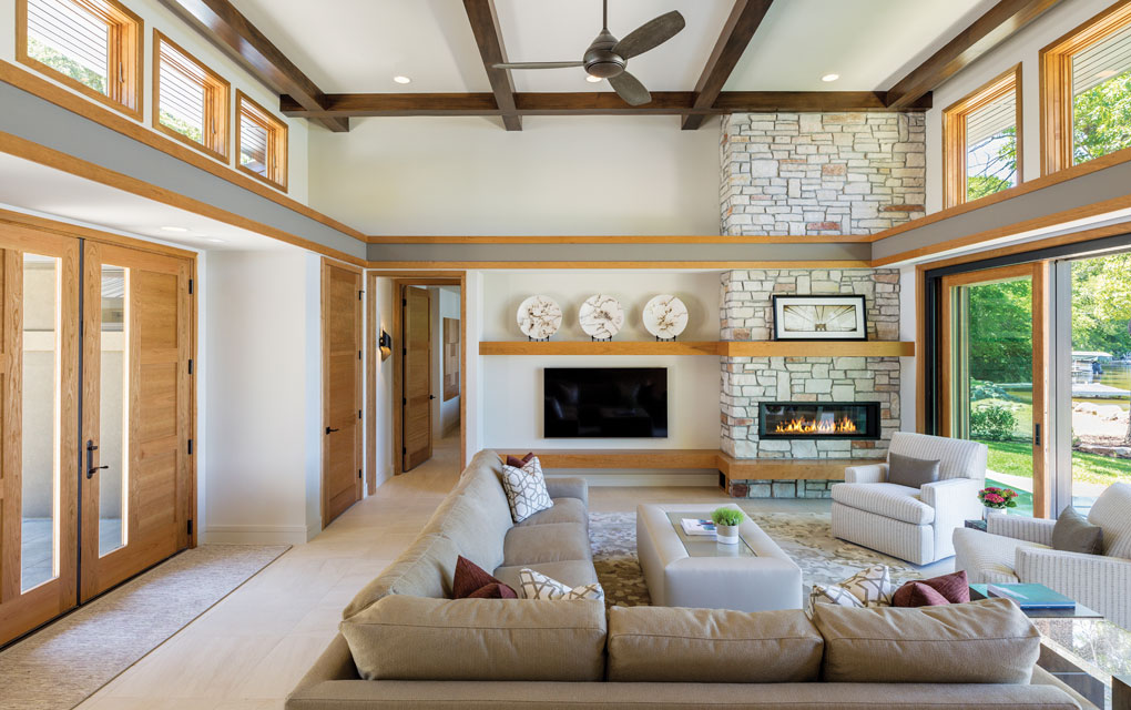 In lieu of window treatments that would block the view, blinds above the doors and windows on the main level are hidden in soffits until needed.