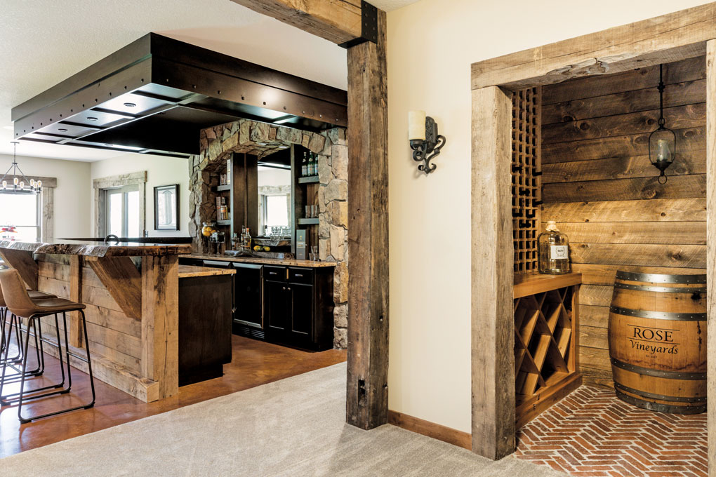 The spacious lower level features a 12-foot bar topped by a 3-inch-thick oak slab, a 350-bottle wine cellar, and a game and media room.