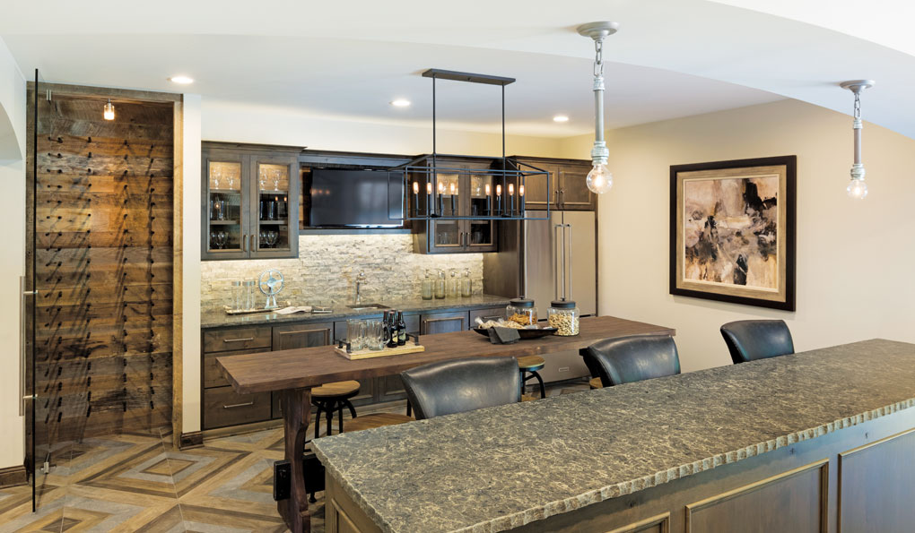 A lower level is made for entertaining. The walls are made of reclaimed barnwood, and a granite-topped island serves as a hub for the wet bar.