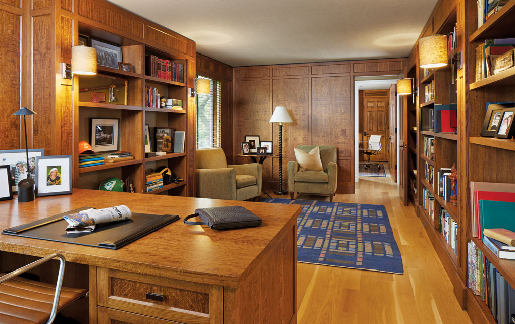 A home study with Old English oak bookcases and paneling.