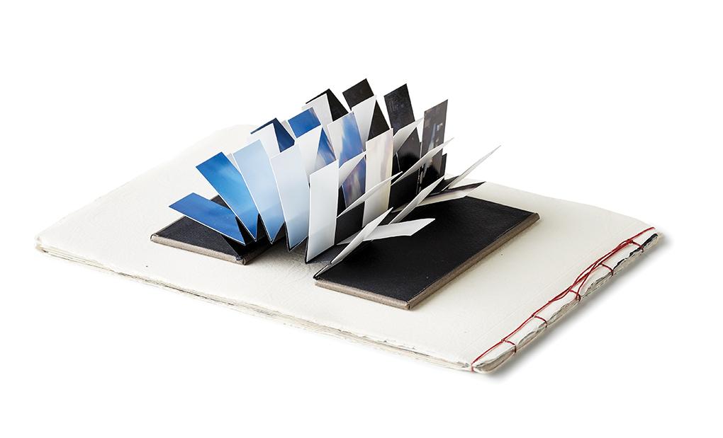 Handmade 3-D book sculpture.