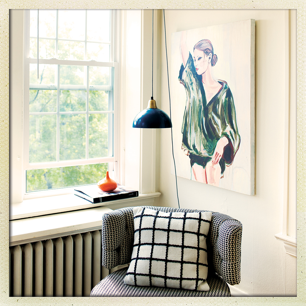 A vintage chair sits underneath a painting of a woman next to a window in a living room.