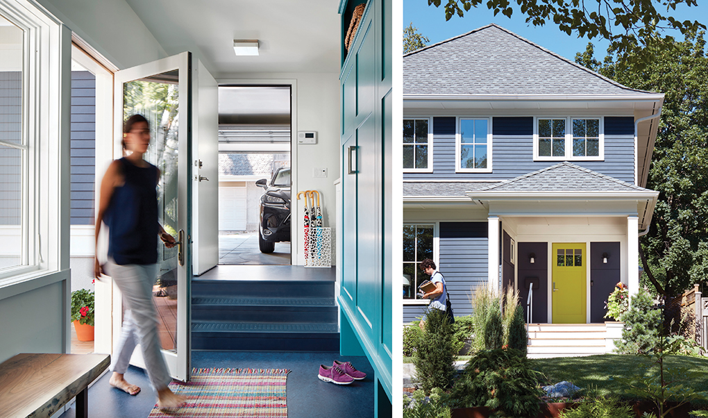 The inside of an entryway shows a multicolored rug on a blue floor that leads to the garage. The exterior of the entryway shows a porch, chartreuse-colored door and navy-colored home.