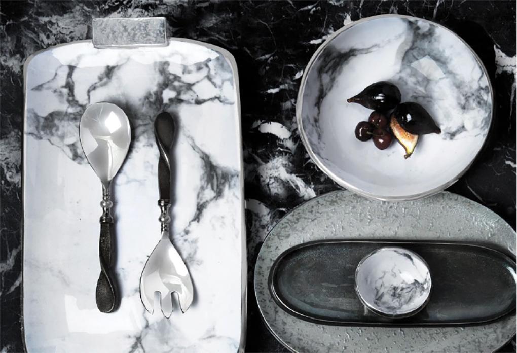 Marble Silverware sitting on Table