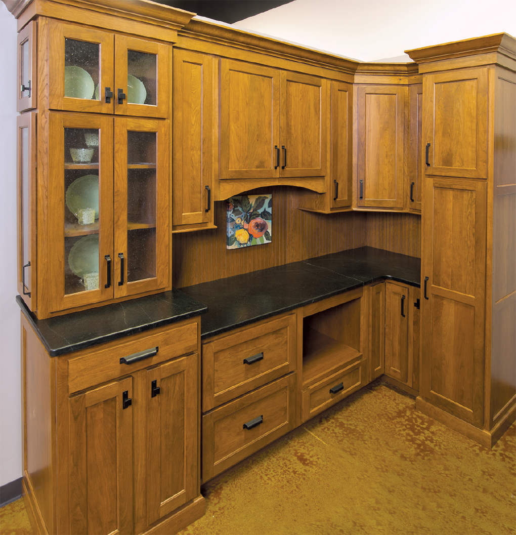 Storage showcase with medium light wood cabinets and black countertop