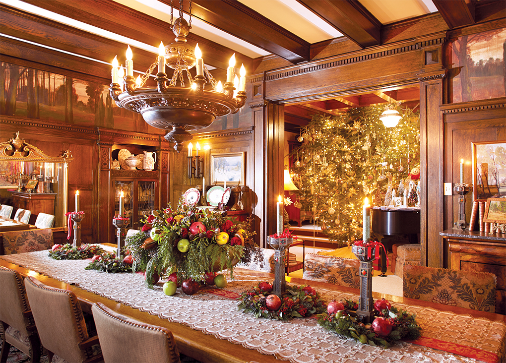 Wood interior dining room with bowl of apples and Christmas tree leaves