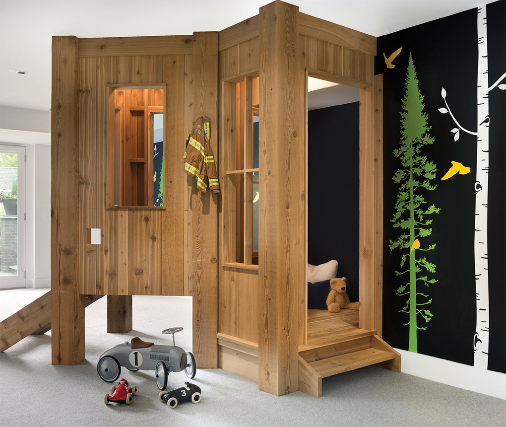 A play treehouse in the basement of a home.