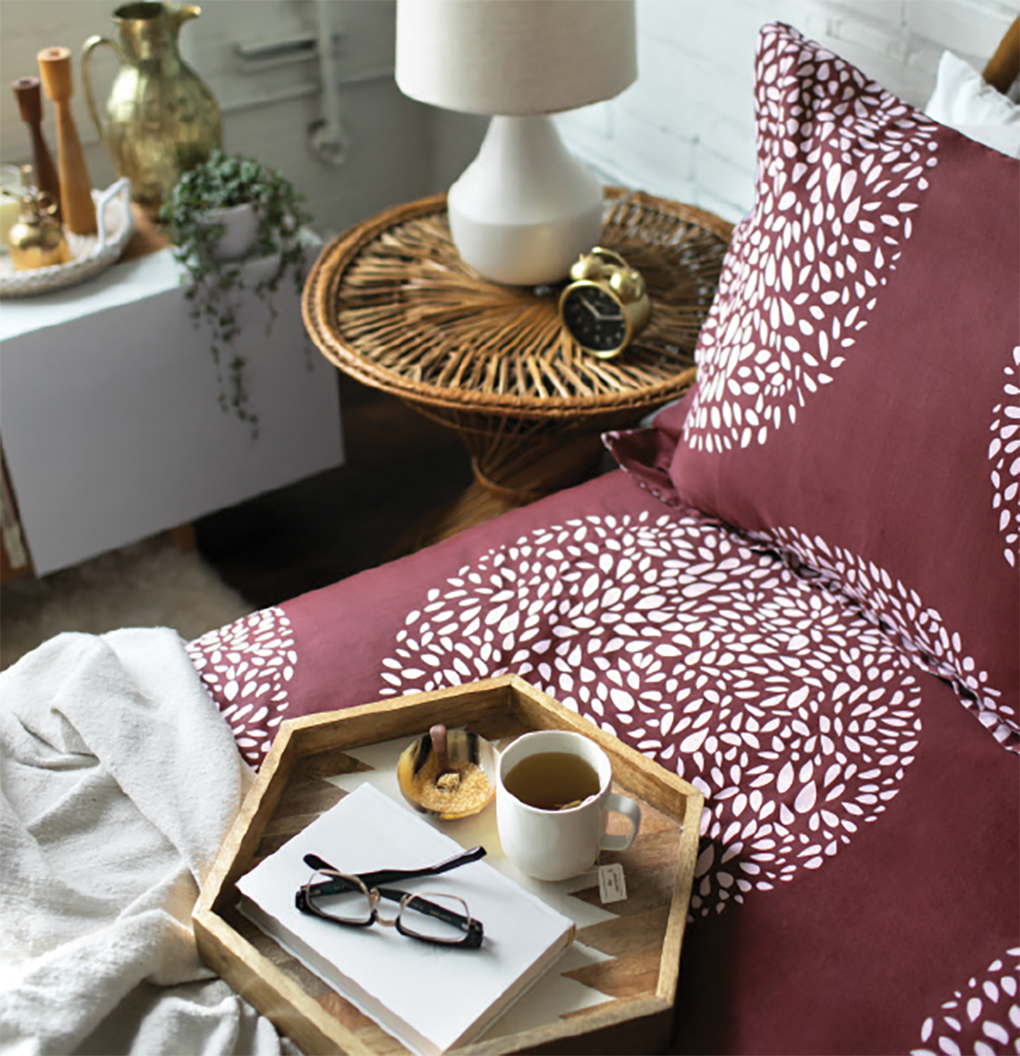 Bedding by Hygge & West with a tray with coffee resting on top.