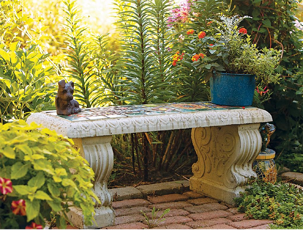 Raimondo created this mosaic garden bench in a memorial garden.