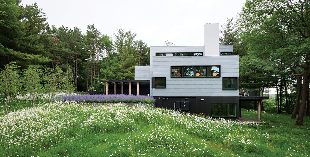 Nestled among among wildflowers and pines, the house is quiet and straighforward: three zinc-clad boxes and a garage of dark Richlite.