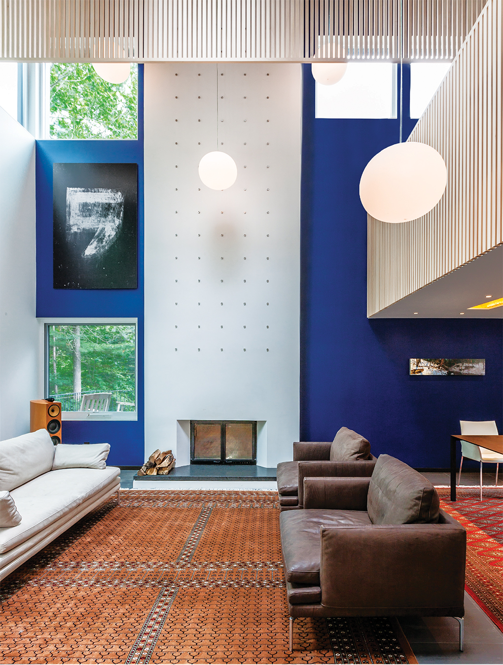 Soaring 22-feet high and embracing the view, the living room is the visual centerpiece of the house.