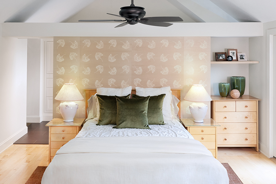 In a bedroom designed by Digiacomo Homes, the airy, organic bedroom is papered in cream and beige Thibaut Andros grasscloth.