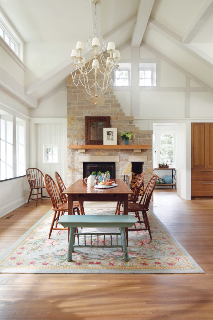 A dining room remodeled by Albertsson Hansen Architecture features a gabled ceiling, dormer windows, and half-timbering on the ceiling.