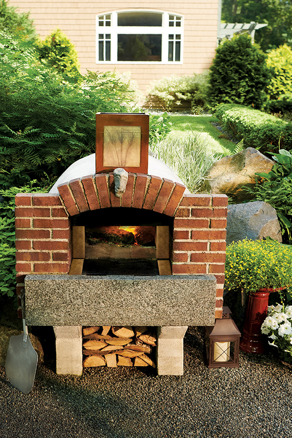 An outdoor, brick pizza oven.