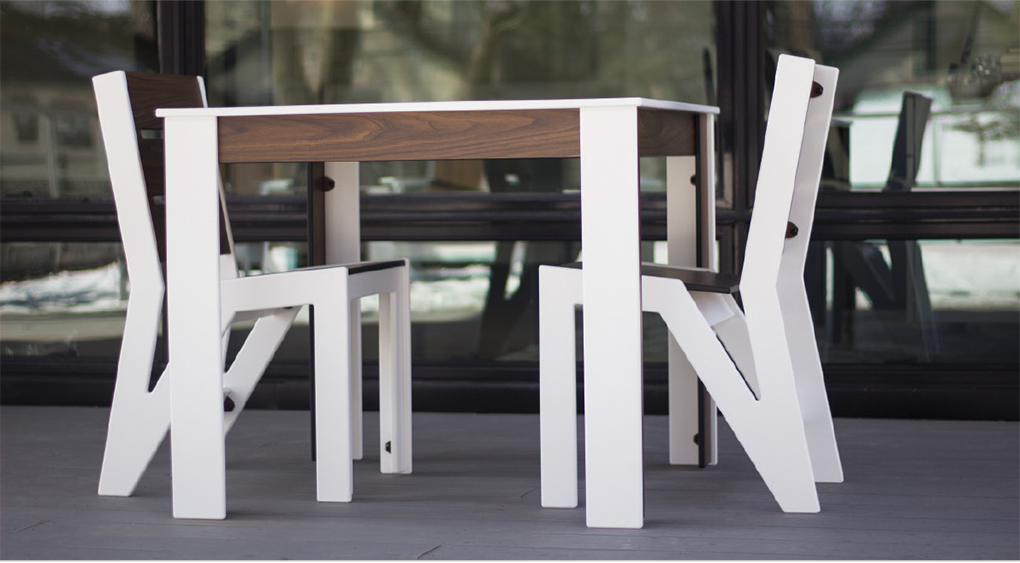 A white dining table by 360 Five Designs.
